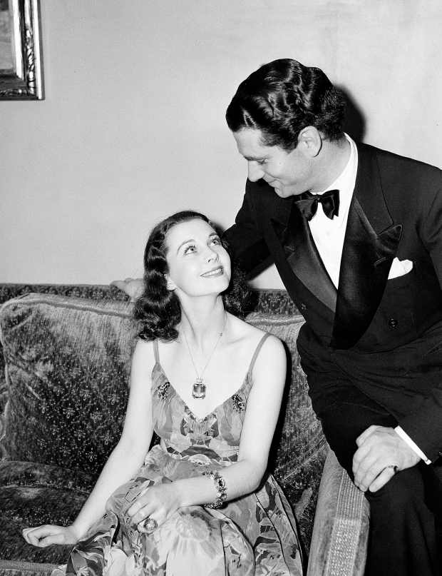 "Vivien Leigh is shown with Laurence Olivier in Hollywood at the annual Banquet of the Motion Picture Academy of Arts and Sciences at which she won an Oscar for her performance as Scarlett O'Hara in ""Gone With The Wind,"" Feb. 29, 1940. (AP Photo)"