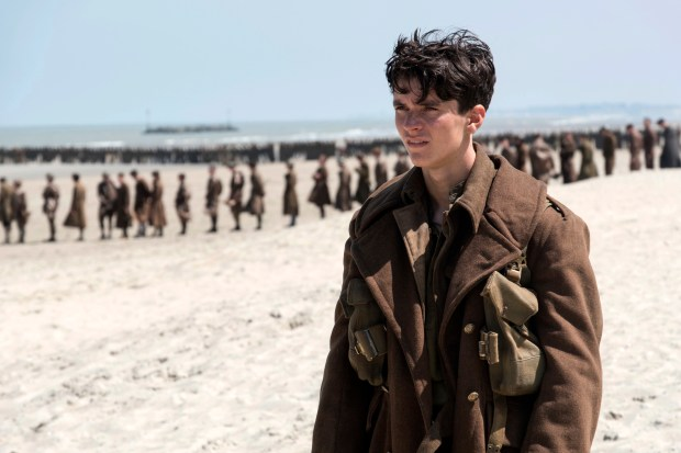 "This image released by Warner Bros. Pictures shows Fionn Whitehead in a scene from ""Dunkirk."" (Melissa Sue Gordon/Warner Bros. Pictures via AP)"
