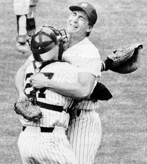 536e0688ca26f5 New York Yankees pitcher Dave Righetti is hugged by catcher Butch Wyneger  after Righetti completed a