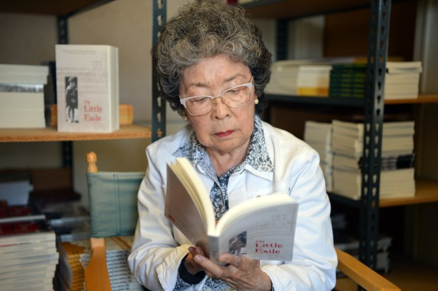"Jeanette Arakawa, the author of ""The Little Exile,"" a new work about her experiences as a young girl in a Japanese internment camp during WWII, reads from her book in Albany, Calif. on Thursday, June 29, 2017. (Kristopher Skinner/Bay Area News Group)"