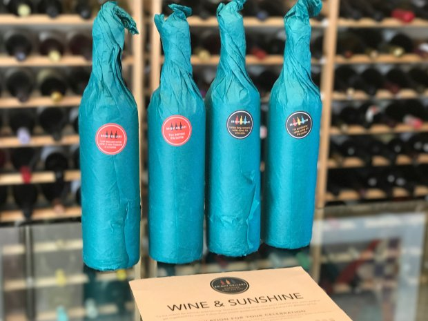 Wine bottles in Bright Cellars' monthly club shipment come wrapped inbright teal tissue paper. (Mary Orlin/Bay Area News Group)