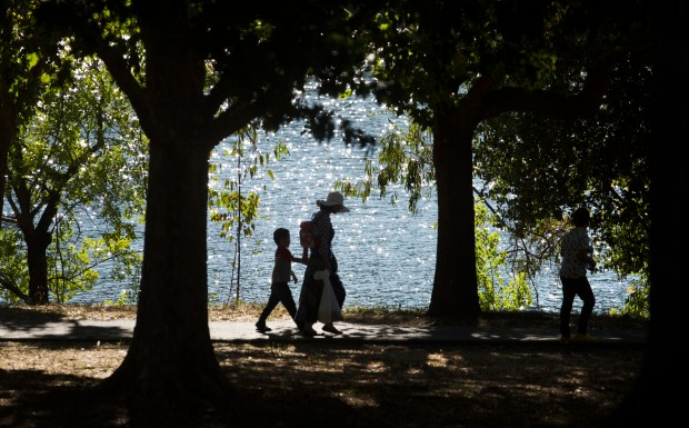 Visitors enjoy a late afternoon stroll at Vasona Lake County Park in Los Gatos, Calif., Wednesday, July 5, 2017. There is a bill in the California legislature to end the twice-annual changing of the clocks -- by landing the state permanently on Standard Time, which we have in the winter. (Patrick Tehan/Bay Area News Group)