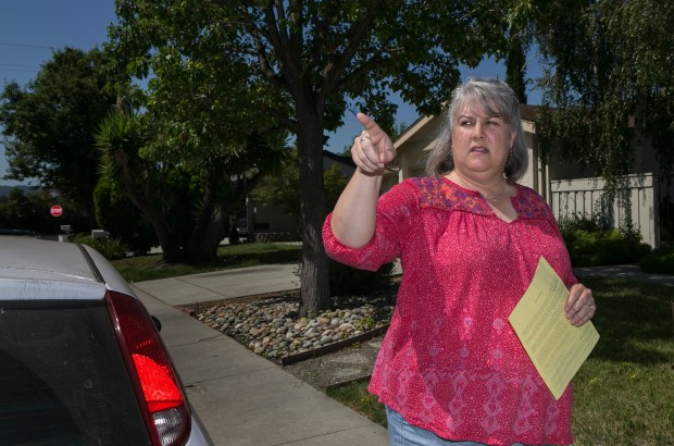 Amy Guzules points to towards another neighbor who received a fireworks citation from the San Jose Fire Department for illegal fireworks in San Jose, California, on Wednesday, July 26, 2017. (LiPo Ching/Bay Area News Group)