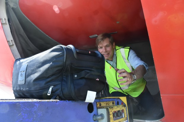 Courtesy Office of Rep. Eric Swalwell - Congressman Eric Swalwell learns what it's like to be a baggage handler for Southwest Airlines at Oakland International Airport in Oakland, Calif. on Saturday, July 22, 2017. Swalwell performed the baggage handling duties as part of his #InYourShoes program, which he says helps him stay connected to the needs and concerns of the average working man and woman in the Congressional district he serves. He also worked as a barista at a Dublin, Calif. Starbuck's coffee shop and has plans to try out other lines of work too.