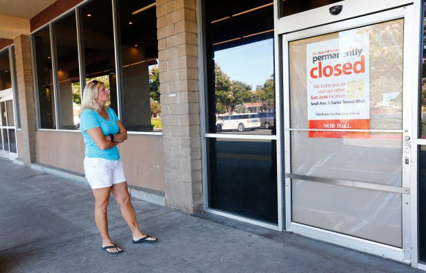 Deirdre Wyness stands in front of the empty storefront vacated by Nob Hill Foods on Santa Teresa Blvd. in San Jose, California, on Friday, July 21, 2017. (Gary Reyes/ Bay Area News Group)