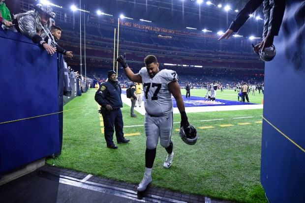 Oakland Raiders' Austin Howard (77) gestures to the fans as he returns to the locker room after losing to the Houston Texans during their AFC West Wild Card round game at the NRG Stadium in Houston, Texas, on Saturday, Jan. 7, 2017. Houston defeated Oakland 27-14. (Jose Carlos Fajardo/Bay Area News Group)