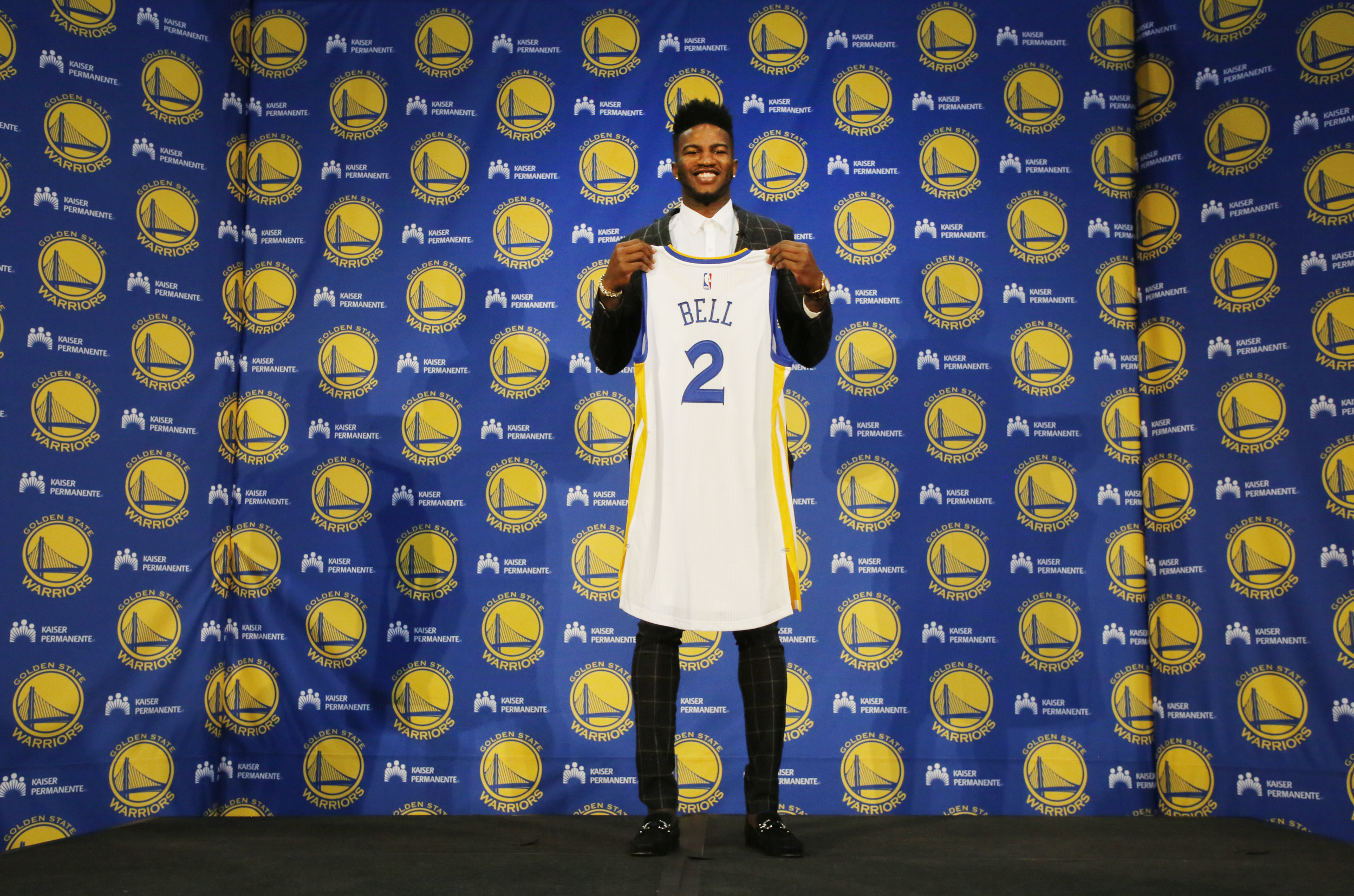 Warriors' draft pick Jordan Bell poses with his jersey at the Warriors' headquarters in Oakland, Calif., on Friday, June 23, 2017. Warriors held a press conference to introduce newest Warrior Jordan Bell. (Laura A. Oda/Bay Area News Group)