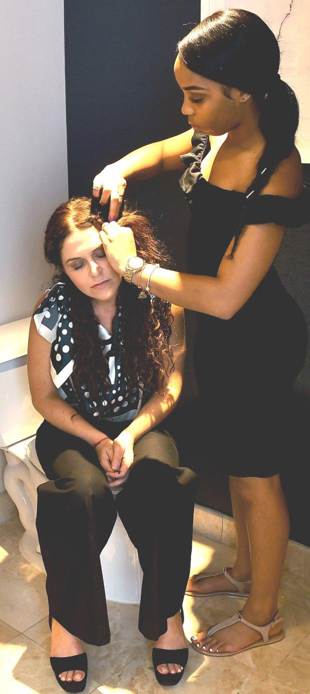 "Tayla Solomon braids the hair of Amanda Lipitz before the Washington, D.C.,premiere of the documentary ""Step."" (Katherine Frey/Washington Post)"
