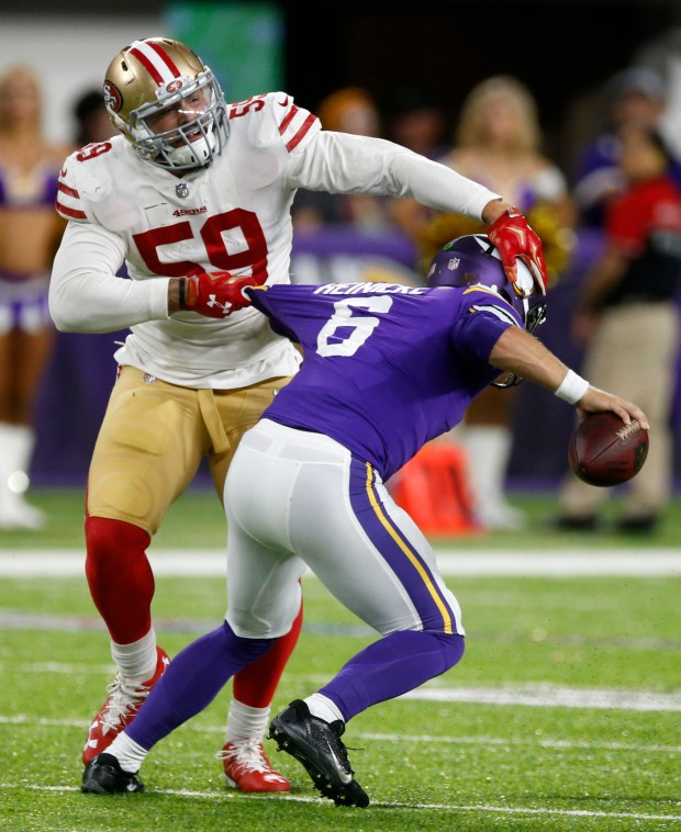San Francisco 49ers outside linebacker Aaron Lynch tackles Minnesota Vikings quarterback Taylor Heinicke during the second half of an NFL preseason football game Sunday, Aug. 27, 2017, in Minneapolis. The Vikings won 32-31. (AP Photo/Jim Mone)