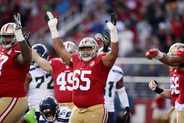 SANTA CLARA, CA - JANUARY 01: Joshua Garnett #65 of the San Francisco 49ers reacts after Shaun Draughn #24 of the San Francisco 49ers ran in for a touchdown against the Seattle Seahawks at Levi's Stadium on January 1, 2017 in Santa Clara, California. (Photo by Ezra Shaw/Getty Images)