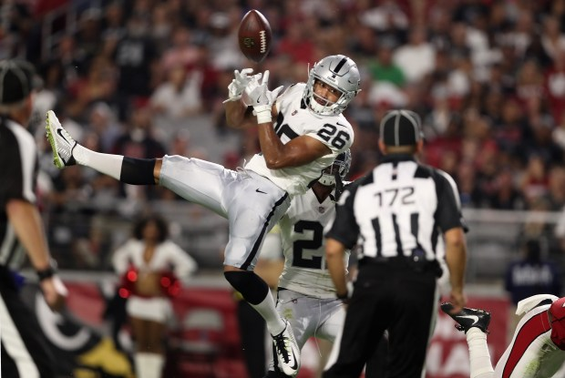 GLENDALE, AZ - AUGUST 12: Safety Shalom Luani #26 of the Oakland Raiders is unable to intercept a pass during the NFL game against the Arizona Cardinals at the University of Phoenix Stadium on August 12, 2017 in Glendale, Arizona. The Cardinals defeated the Raiders 20-10. (Photo by Christian Petersen/Getty Images)