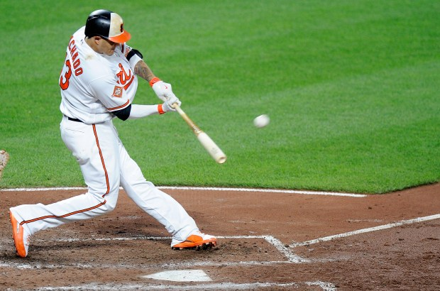BALTIMORE, MD - AUGUST 22: Manny Machado #13 of the Baltimore Orioles hits a two-run home run in the sixth inning against the Oakland Athletics at Oriole Park at Camden Yards on August 22, 2017 in Baltimore, Maryland. (Photo by Greg Fiume/Getty Images)