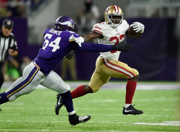 Joe Williams #32 of the San Francisco 49ers carries the ball against Willie Beavers #64 of the Minnesota Vikings during the fourth quarter in the preseason game on August 27, 2017 at U.S. Bank Stadium in Minneapolis, Minnesota. The Vikings defeated the 49ers 32-31. (Photo by Hannah Foslien/Getty Images)
