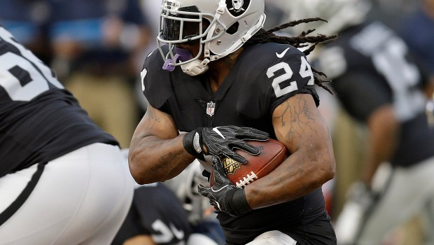 FILE - In this Aug. 19, 2017, file photo, Oakland Raiders running back Marshawn Lynch (24) runs against the Los Angeles Rams during the first half of an NFL preseason football game in Oakland, Calif. The Oakland Raiders are no longer mired in mediocrity thanks to quarterback Derek Carr, who has newfound security in both a shiny $125 million contract and in unretired running back Marshawn Lynch with him in the backfield. (AP Photo/Ben Margot, File)