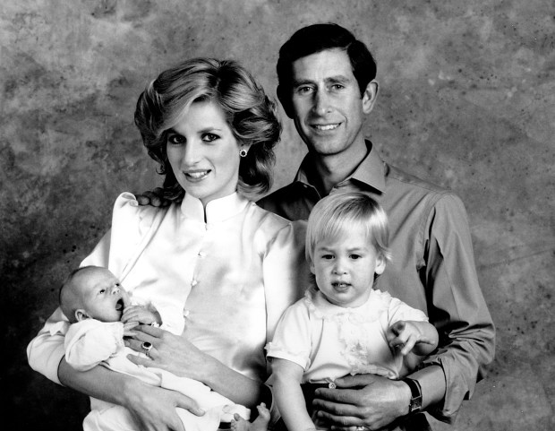 The Prince and Princess of Wales, Prince Charles and Princess Diana, pose for a family portrait with their sons, Prince William, right, and Prince Harry, at the Kensington Palace in London, England on Oct. 6, 1984. Prince Harry was born on Sept. 15. Prince William was born June 21, 1982. (AP Photo)
