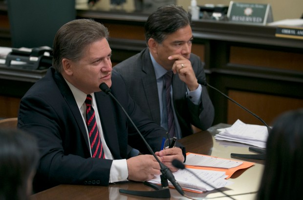 FILE - In this April 18, 2017 file photo, state Sen. Robert Hertzberg, D-Van Nuys, left, answers a question concerning a proposed measure he and Assemblyman Rob Bonta, D-Oakland, right, authored to change California's bail bond system during a hearing of the Assembly Public Safety Committee, in Sacramento, Calif. Gov. Jerry Brown and California Supreme Court Chief Justice Tani Cantil-Sakauye promised, Friday, Aug. 25, 2017 to study the issue and try again next year to the approve the measure that would dramatically change the states pretrial release policies. (AP Photo/Rich Pedroncelli, File)
