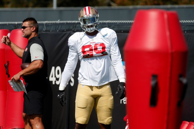 The San Francisco 49ers' DeForest Buckner (99) Wednesday, Aug. 2, 2017, works out at the team's training camp in Santa Clara, California, alongside defensive line coach Jeff Zgonina. (Karl Mondon/Bay Area News Group)