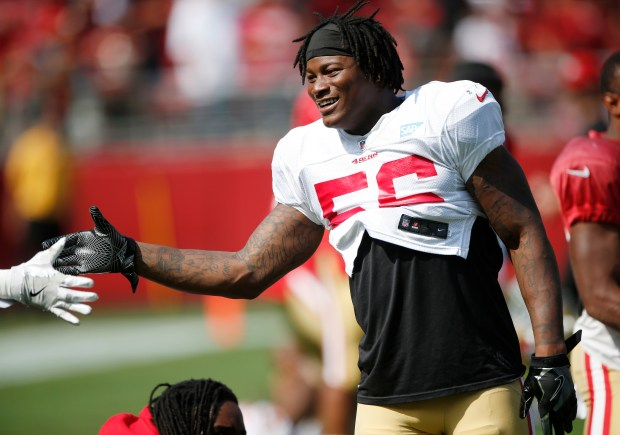 Reuben Foster, at right, greets a teammate during San Francisco 49ers practice at Levi's Stadium on Saturday, Aug. 5, 2017, in Santa Clara, Calif. (Jim Gensheimer/Bay Area News Group)