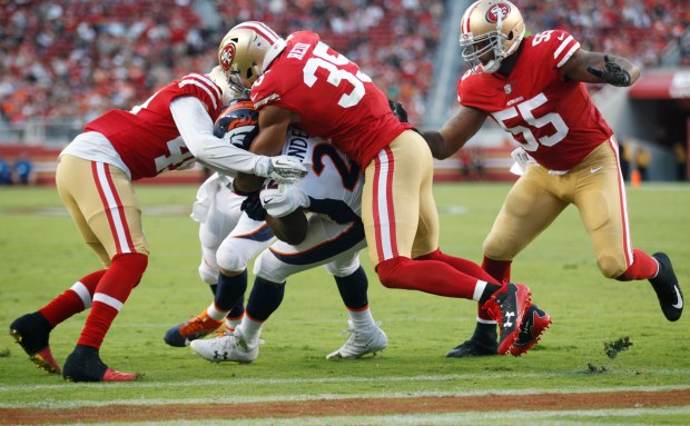 San Francisco 49ers safety Lorenzo Jerome (49) and free safety Eric Reid (35) can't stop Denver Broncos running back C.J. Anderson (22) from scoring a touchdown in the first quarter at Levi's Stadium on Saturday, Aug. 19, 2017, in Santa Clara, Calif. (Jim Gensheimer/Bay Area News Group)