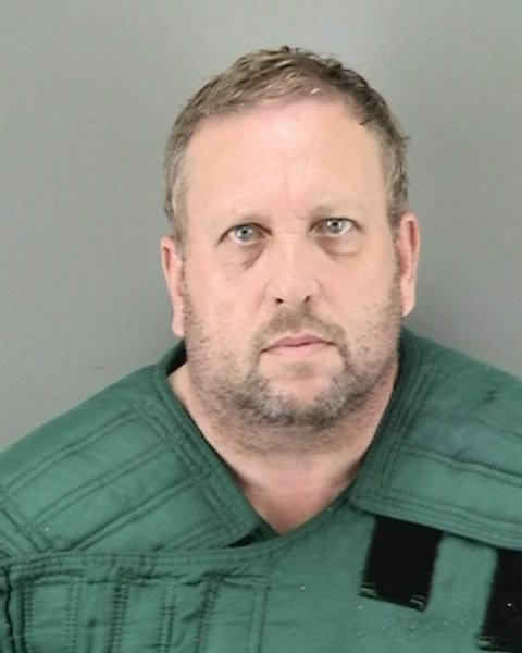 Andrew Warren, 56, pictured above, is in a San Francisco jail after hisarrest for a fatal stabbing in Chicago. (Courtesy of San Francisco Police Department)