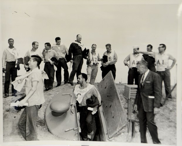 A copy photograph from December 1959 of a Naval Radiology Laboratory bomb shelter experiment copied at the Alameda County Sheriff's office archives in Dublin, Calif., on Tuesday, Aug. 22, 2017. There are some photos, documents and relics related to the Cold War and the nuclear threat housed there. This photo shows people exiting the bomb shelter. (Dan Honda/Bay Area News Group)