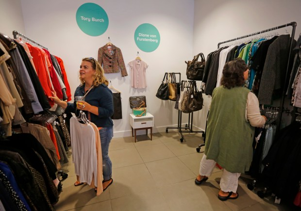 Brie Quinn, left, from Marin, shops with her mother Donna Hokanson from Santa Rosa, at the newly opened ThredUp store in downtown Walnut Creek, Calif., on Thursday, Aug. 17, 2017. Quinn is a big fan of the online store and was expecting a crowd. Like Amazon, ThredUp, an online thrift store, is getting into the brick-and-mortar business. The Walnut Creek store that opened Thursday is the second physical location. (Laura A. Oda/Bay Area News Group)