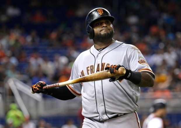 San Francisco Giants' Pablo Sandoval walks to the dugout after flying out during the sixth inning of a baseball game against the Miami Marlins, Tuesday, Aug. 15, 2017, in Miami. (AP Photo/Lynne Sladky)