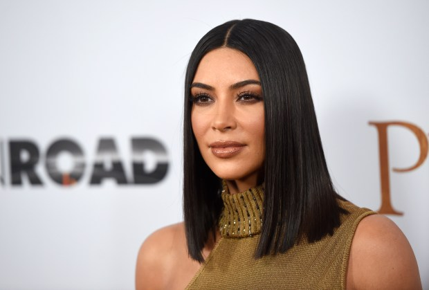 "FILE - In this April 12, 2017, file photo, Kim Kardashian West arrives at the U.S. premiere of ""The Promise"" at the TCL Chinese Theatre in Los Angeles. Kardashian West was trending on social media after defending makeup artist Jeffree Star as an asset to her cosmetics empire despite his history of racist remarks and calling her fans ""petty"" for bringing up his past. Kardashian West said in a Snapchat video Tuesday, Aug. 15, that she's sorry for ""feeling like I had the right to say 'get over it' in a situation that involves racism."" (Photo by Chris Pizzello/Invision/AP, File)"