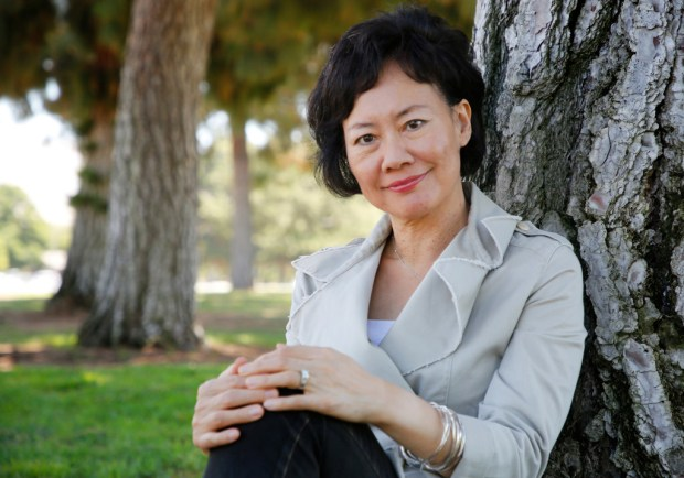"Chinese-American author Maggie Shen King is photographed in Fremont, Calif., on Monday, July 24, 2017. King has written ""An Excess Male"", a chilling dystopian tale based on China's ""one child only"" policy of a government that reacts to a crisis of its own creation by redefining the boundaries of marriage and tampering yet again with sex and reproduction in the name of the public good.(Laura A. Oda/Bay Area News Group)"