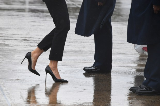 First Lady Melania Trump walks on high heels to board Air Force One at Andrews Air Force Base, Maryland, on August 29, 2017 en route to Texas to view the damage caused by Hurricane Harvey. / AFP PHOTO / JIM WATSON (Photo credit should read JIM WATSON/AFP/Getty Images)