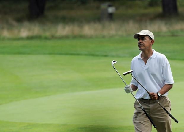 US President Barack Obama arrives at the 9th hole for putt as he plays golf at the the Mink Meadows Golf Course in Vineyard Haven on Martha's Vineyard, Massachusetts, on August 25, 2009. After a brutal seven months facing economic blight, rising trouble abroad and fighting for an increasingly under-fire agenda, Obama and the First family are on a week-long vacation on the exclusive island of Martha's Vineyard. AFP PHOTO/Jewel SAMAD (Photo credit should read JEWEL SAMAD/AFP/Getty Images)