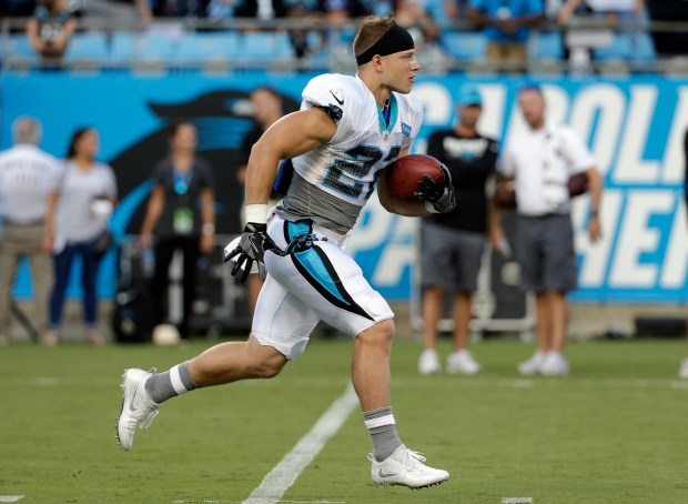 Carolina Panthers' Christian McCaffrey (22) runs with the ball during practice at the NFL football team's Fan Fest in Charlotte, N.C., Friday, Aug. 4, 2017. (AP Photo/Chuck Burton)