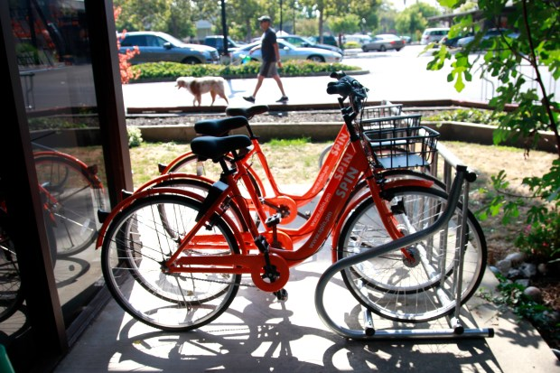 Bikes from the bikesharing company Spin, wait for customers outside the Chamber of Commerce building in Mountain View, California, on Monday, Aug. 7, 2017. (Karl Mondon/Bay Area News Group)