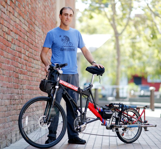 Michael K. Norris, of Box Bike by DIYBIKING.COM a San Jose-made cargo bikes, is photographed with his original Mad Max fold-up cargo bike in San Jose, Calif., on Monday, August 14, 2017. (Josie Lepe/Bay Area News Group)