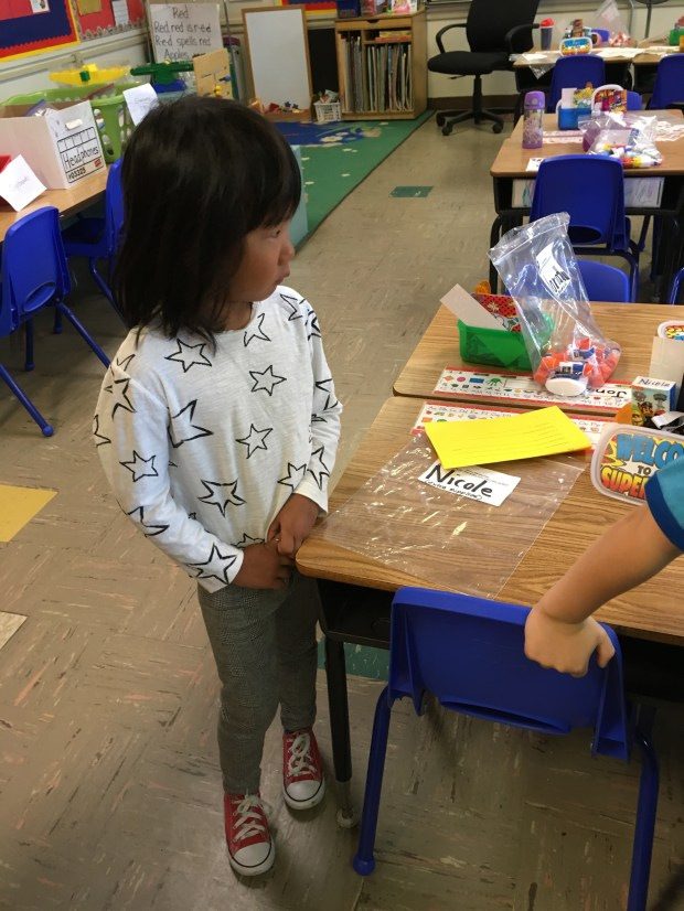 Nicole Newman, 4, experiences a little first-day-of-kindergarten trepidation after father Bruce took her to her school in Santa Clara. After shedding a few tears she settled in to her first day, on Monday, August 29, 2017. (Courtesy Wei Wang)