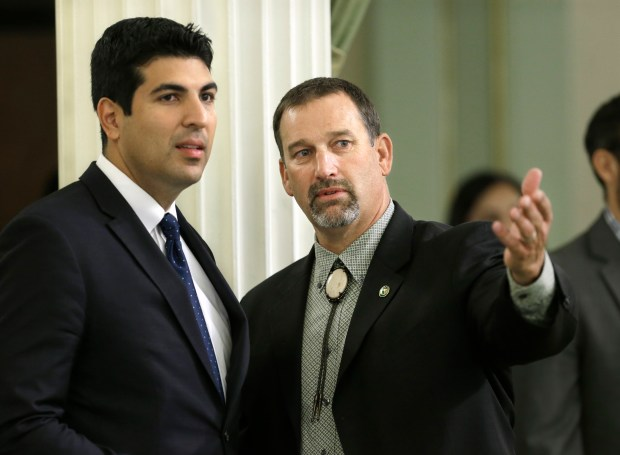 California assemblymen Matthew Dababneh, D-Encino, left, and Brian Dahle, R-Bieber, discuss legislation during the Assembly session Friday, Sept. 4, 2015, in Sacramento, Calif. On Thursday, August 24, 2017, Dahle was elected Assembly Republican leader in a party shake-up. (AP Photo/Rich Pedroncelli)