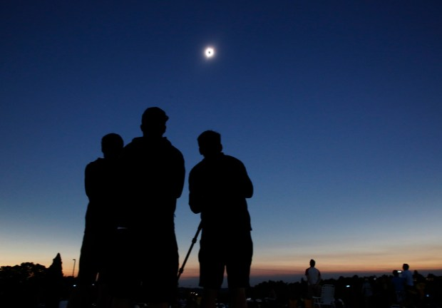 Charlie Tran, Tanner Lea, and Dennis Tran experience the total eclipse in Salem, Oregon on Monday, Aug. 21, 2017. The three friends traveled from Seattle Washington to see the event. (Laura A. Oda/Bay Area News Group)