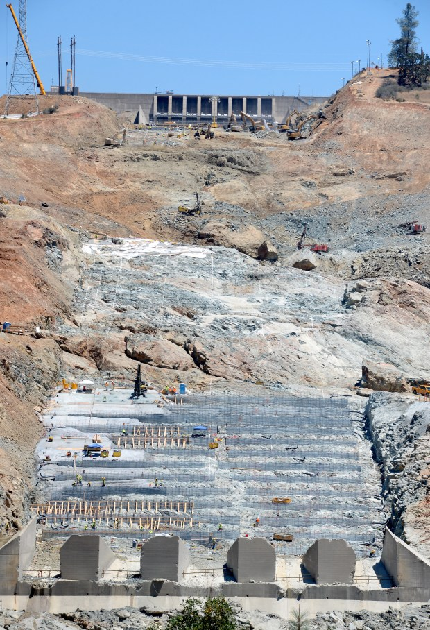 Cranes and workers can be seen around the Spillway as construction continues at the Lake Oroville Dam Spillway Monday, July 17, 2017. (Bill Husa -- Enterprise-Record)
