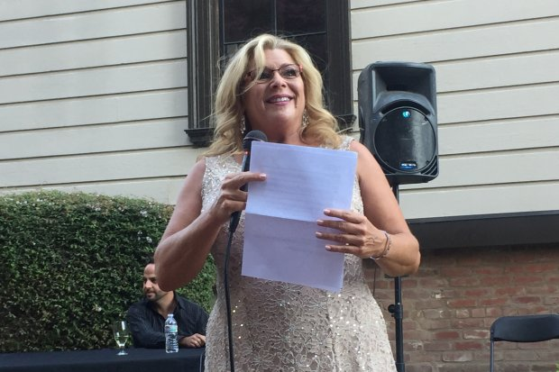 """Lisa Mallette, executive artistic director of City Lights Theater Company,talks to the crowd during the summer fundraiser, """"Axes & Ohhs,"""" which was held at the historic Fallon House in downtown San Jose on Saturday, Aug. 5, 2017. (Sal Pizarro/Staff)"""