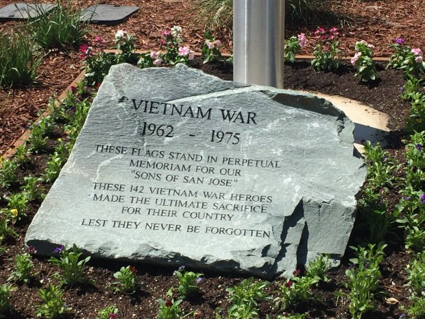 A memorial to the 142 San Jose residents who lost their lives in theVietnam War was carved into a 2,000 pound rock and placed in front of a flag pole at Little Orchard Mini Storage in San Jose. (Sal Pizarro/Bay Area News Group)