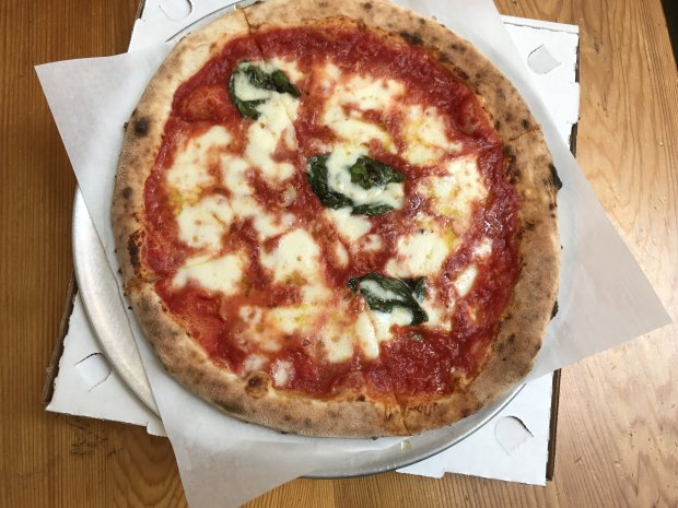 The classic Margherita Neapolitan pizza is served at Pizzetta 408 in SanJose's SoFA Market. (Mary Orlin/Bay Area News Group)