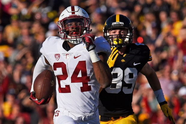 Stanford Cardinal's Quenton Meeks (24) intercepts a pass intended for Iowa Hawkeyes' Matt VandeBerg (89) and runs it back for a touchdown in the first quarter of the 102nd Rose Bowl game at the Rose Bowl Stadium in Pasadena, Calif., on Friday, Jan. 1, 2016. (Jose Carlos Fajardo/Bay Area News Group)