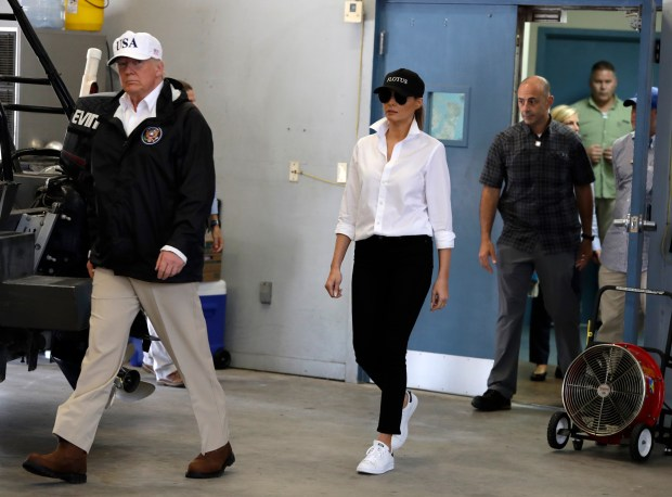 President Donald Trump and first lady Melania Trump arrive take part in a briefing on Harvey relief efforts, Tuesday, Aug. 29, 2017, at Firehouse 5 in Corpus Christi, Texas. (AP Photo/Evan Vucci)