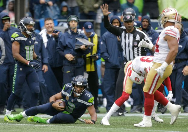 SEATTLE, WA - SEPTEMBER 17: Quarterback Russell Wilson #3 slides after escaping for a run during the third quarter of the game against the San Francisco 49ers at CenturyLink Field on September 17, 2017 in Seattle, Washington. (Photo by Stephen Brashear/Getty Images)