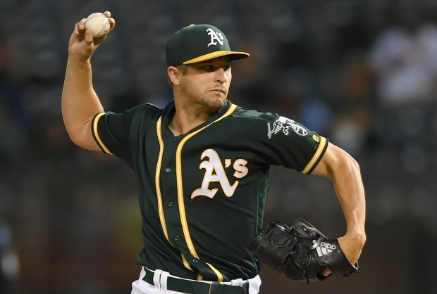 OAKLAND, CA - SEPTEMBER 22: Kendall Graveman #49 of the Oakland Athletics pitches against the Texas Rangers in the top of the first inning at Oakland Alameda Coliseum on September 22, 2017 in Oakland, California. (Photo by Thearon W. Henderson/Getty Images)