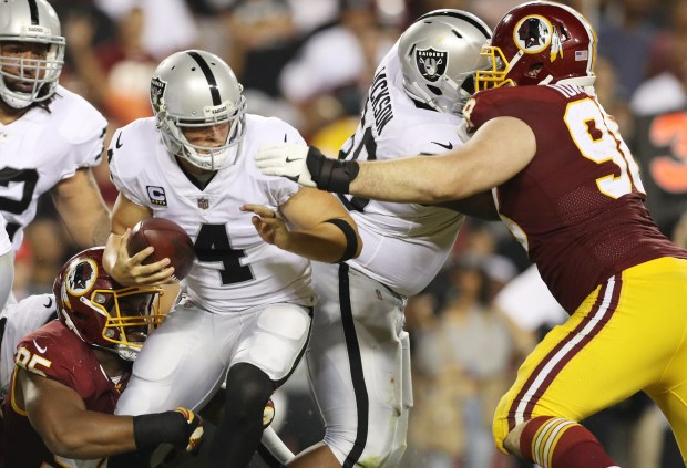 Washington sacked Derek Carr four times Sunday night. (Photo by Patrick Smith/Getty Images)