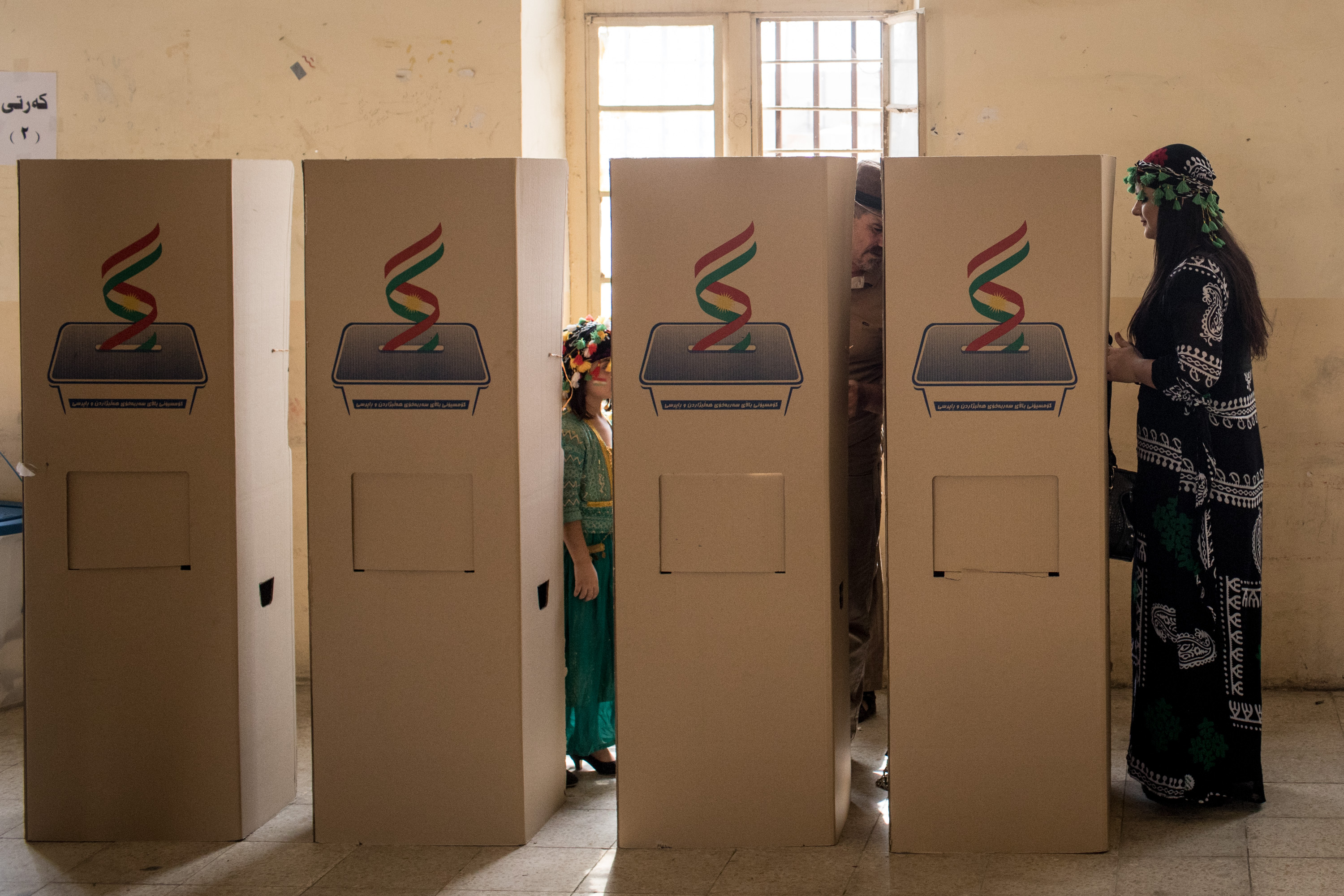 A woman waits to cast her referendum vote at a voting station on September 25, 2017 in Kirkuk, Iraq. Despite strong objection from neighboring countries and the Iraqi government. Some five million Kurds took to the polls today across three provinces in the historic independence referendum. (Photo by Chris McGrath/Getty Images)