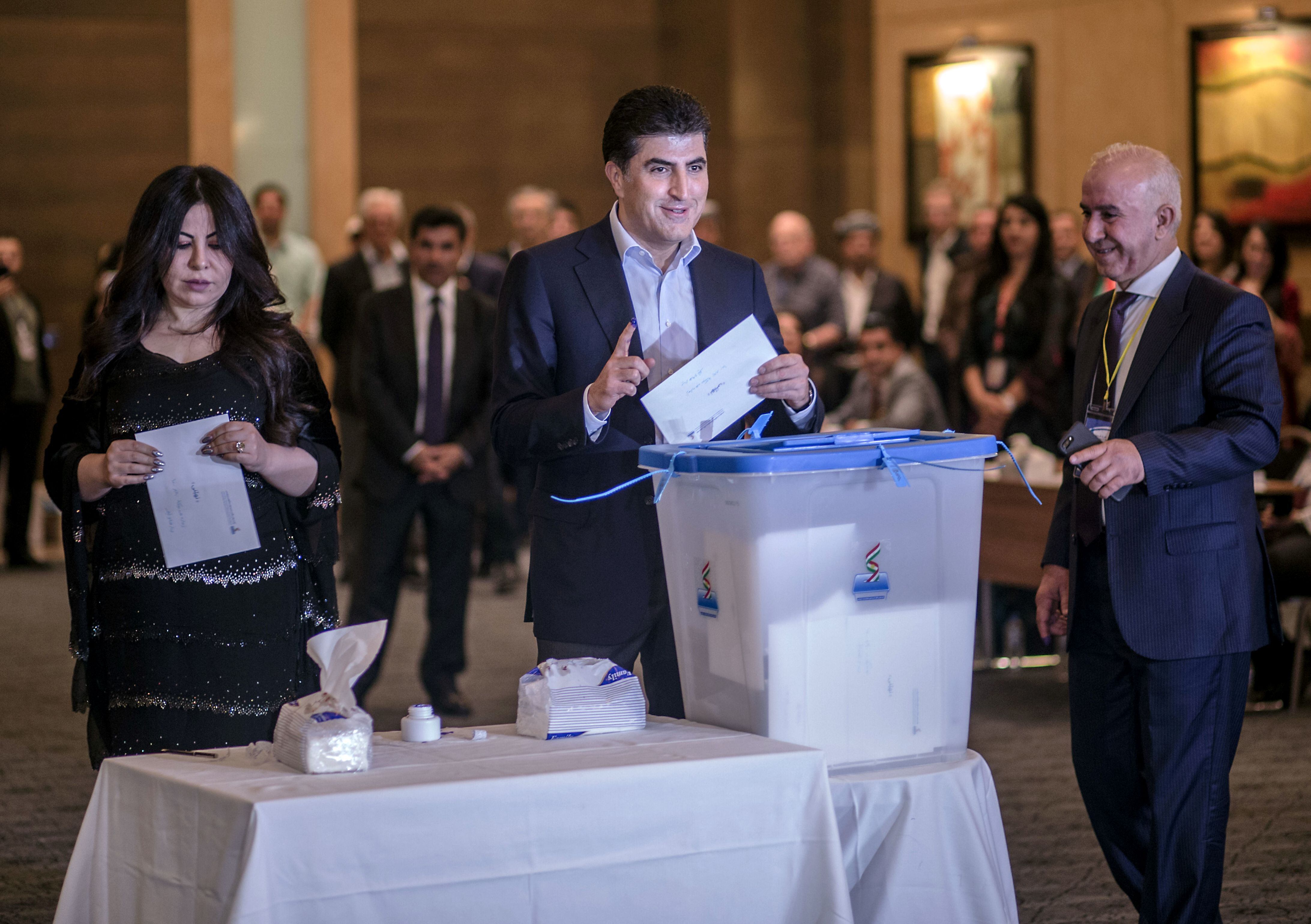 Prime Minister of the Kurdistan Regional Government (KRG) Nechirvan Barzani (C) and his wife Nabila (L), cast their vote for the Kurdish independence referendum at a hotel in Arbil on September 25, 2017. Iraqi Kurds voted in an independence referendum, defying warnings from Baghdad and their neighbours in a historic step towards a national dream. / AFP PHOTO / AHMED DEEBAHMED DEEB/AFP/Getty Images