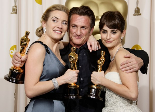 """From left, British actress Kate Winslet holds the Oscar for best actress for her work in """"The Reader"""", Sean Penn holds the Oscar for best actor for his work in """"Milk"""", and Spanish actress Penelope Cruz holds the Oscar for best supporting actress for her work in """"Vicky Cristina Barcelona"""" during the 81st Academy Awards Sunday, Feb. 22, 2009, in the Hollywood section of Los Angeles. (AP Photo/Matt Sayles)"""