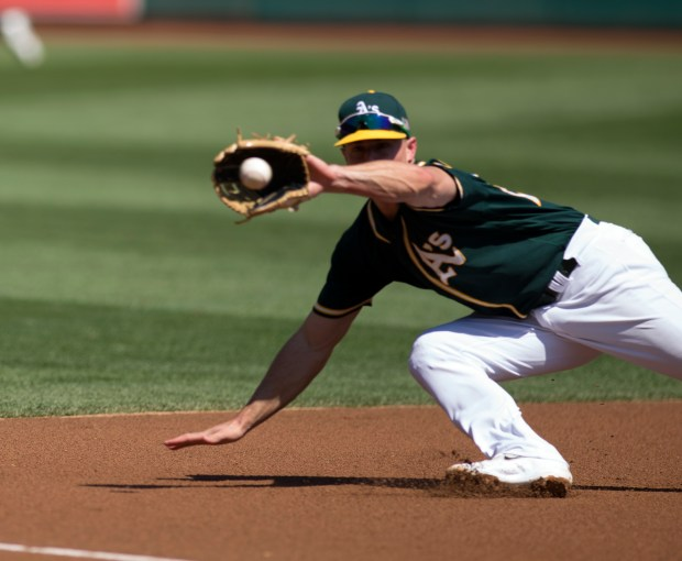 Oakland Athletics' Matt Chapman (26) dives in vain for a double by Houston Astros' Jose Altuve during the first inning of a baseball game, Sunday, Sept. 10, 2017, in Oakland, Calif. (AP Photo/D. Ross Cameron)